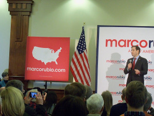 Joni Ernst (left) watches Marco Rubio speak in Des Moines.