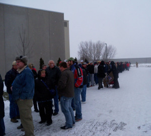 People wait in line in the snow to see Donald Trump in Ames.