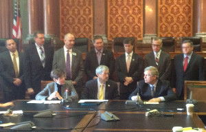 Lt. Governor Reynolds, Governor Terry Branstad and Ag Secretary Tom Vilsack. (seated L-R)
