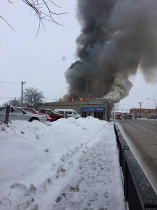 An explosion and fire destroyed a Mason City business Monday.