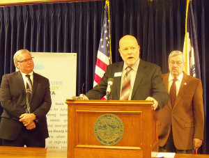 Chris Durree talks about the Future Ready Iowa Summit, with Roger Hargens (left) and Governor Branstad.