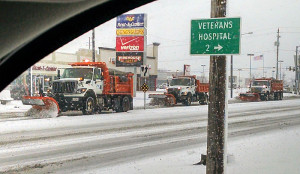 Snowplows clearing streets in Des Moines.