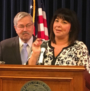 Heather Link speaks at Governor Terry Branstad's weekly news conference