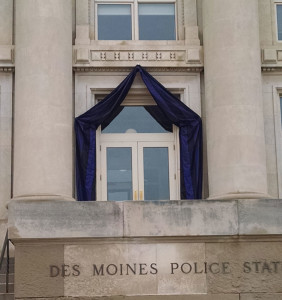 Black bunting was place over the entrance of the Des Moines Police Department following the deaths of 2 officers.
