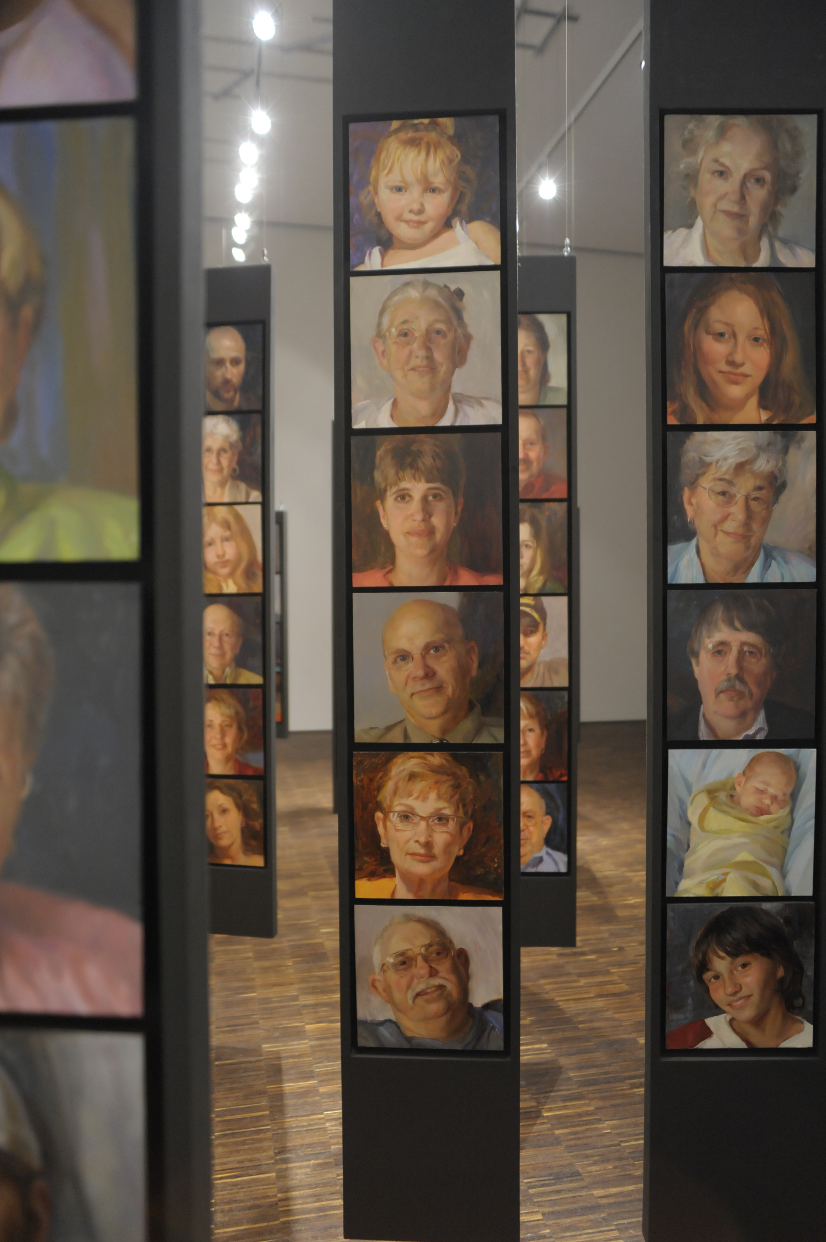 One side of the exhibit features Maquoketa residents' portraits...