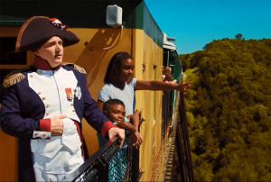 Napoleon riding the Boone and Scenic Valley Railroad in a tourism commercial.