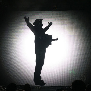 Garth Brooks' silhouette on a big screen got the crowd roaring in anticipation.