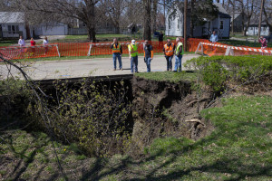 City workers inspect the sinkhole.
