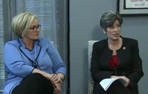 Missouri Senator Claire McCaskill listens to Iowa Senator Joni Ernst.