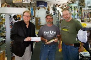 Iowa Great Lakes Area Chamber of Commerce president Jeff Thee, left, Steve Quail of Spencer, center, and John Wittkamp, owner of Stan's Bait and Tackle in Milford.
