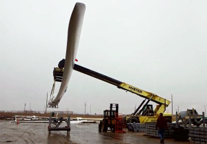 A TPI video shows a wind blade being moved a the Newton factory.