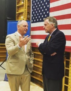 Governor Edwards, left, and Governor McAuliffe chat after news conference