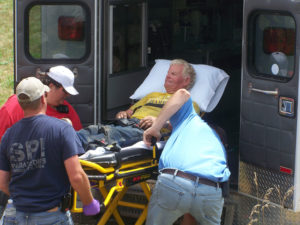 "Stewart ""Skip"" Harris as he was being loaded in the Akron Ambulance after being rescued."