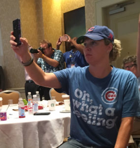 Ingrid Olson was among those using a smart phone as Bernie Sanders spoke to Iowans at the DNC .