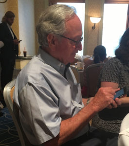 Tom Harkin checks his phone at the Democratic convention.