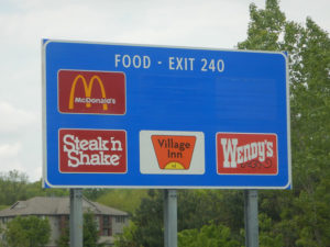 Businesses pay to have their logos advertised on signs like this along state roadways.
