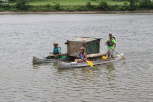 Volunteers with a dumpster pulled from the Des Moines River.