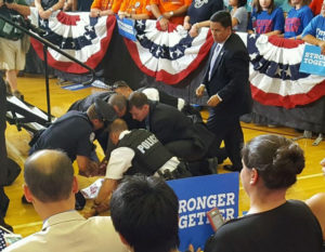 Secret Service members subdue the protestor at the Clinton rally.