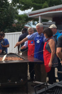 Mike Pence turns pork chops.