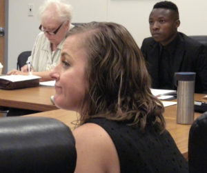 Nicole Proesch listens to Board of Education members.