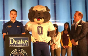 Drake's mascot stands between student body president Nathan Paulsen and Paul Pate