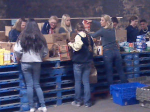 Volunteers pack food.