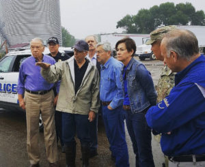 Iowa Senator Chuck Grassley (left) with Governor Terry Branstad, Lt. Governor Kim Reynolds and Congressman Steve King surveying flood damage in Clarksville.