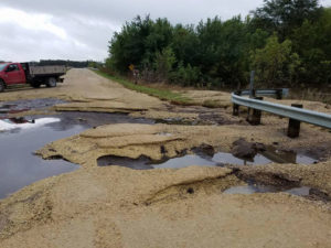 Flood damage to the roadway in Bremer County near Janesville.