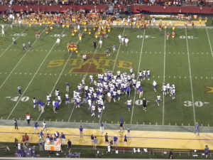 UNI players celebrate after upsetting Iowa State.