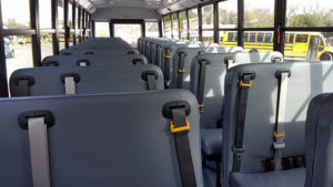 A bus fitted with seatbelts.