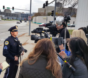 Sgt. Paul Parizek talks with the media.