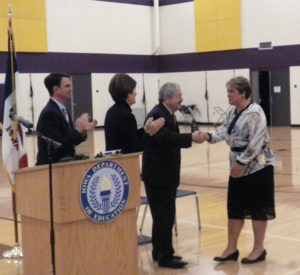 Governor Terry Branstad congratulates Teacher of the Year