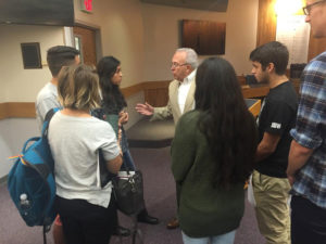 Supervisor John Mauro talks with teens.