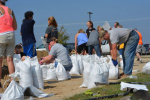 Volunteers filling sandbags before the river crest.