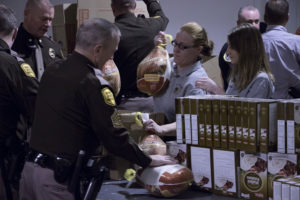 Arresting Hunger food boxes being filled at the Iowa Food Bank.