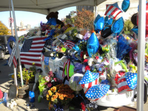 A Des Moines police car covered in memorials to the fallen officers.