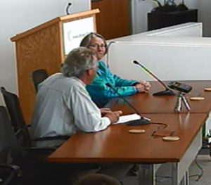 Mark Edwards and Carolyn Raffensburger speak to the Iowa Utilities Board.