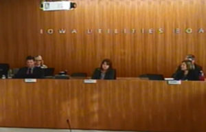 Members of the Iowa Utilities Board listen during Thursday's meeting.