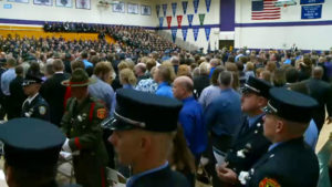 Officers filled the gym at Justin Martin's funeral.