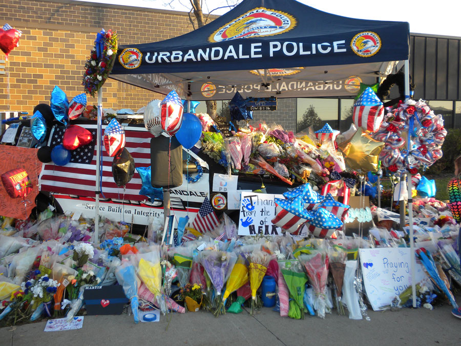 Group says it will donate to officers' families