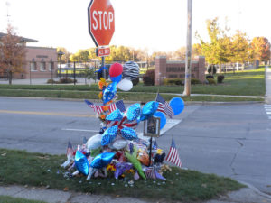 A memorial at the intersection near Urbandale High School where officer Justin Martin was killed.
