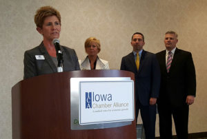 Tara Barney (at podium), Quad Cities Chamber of Commerce; Molly Grover, Dubuque Area Chamber; Jason Hutcheson, Greater Burlington Partnership; Chris McGowan, Siouxland Chamber of Commerce. (L-R)