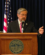 Governor Terry Branstad talks to reporters.
