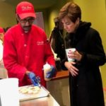 Governor Reynolds makes donuts during stop in Sigourney